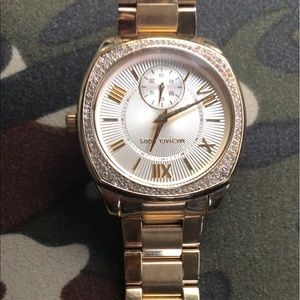 Women's Micheal Kors gold watch.